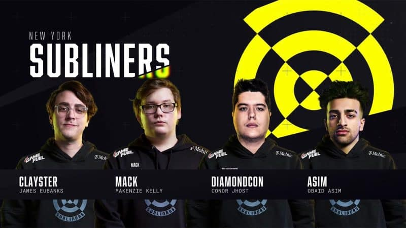 The roster for the New York Subliners stand in front of their team logo, the viewfinder of a submarine scope in yellow and black